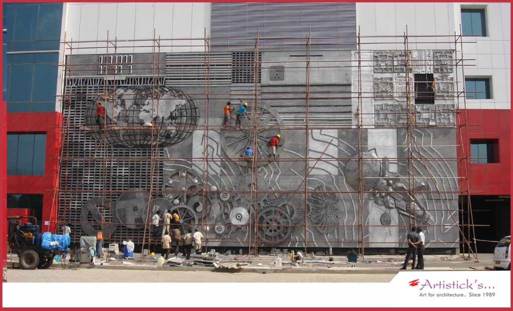Large metal wall murals project from artisticks